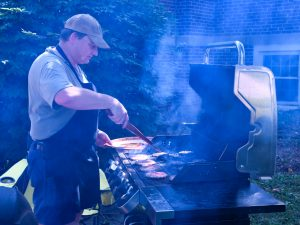 The grillmaster at work during the 2018 picnic.