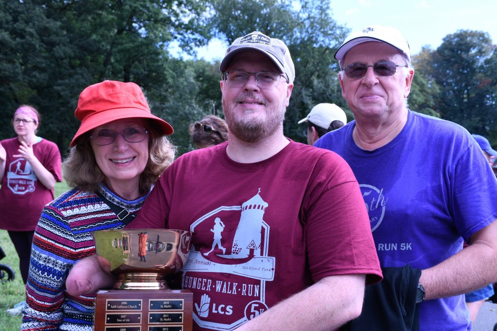 A trophy with three St. Mark's team members.