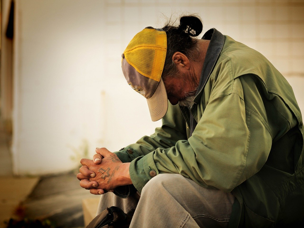 Image of a man bowed in prayer
