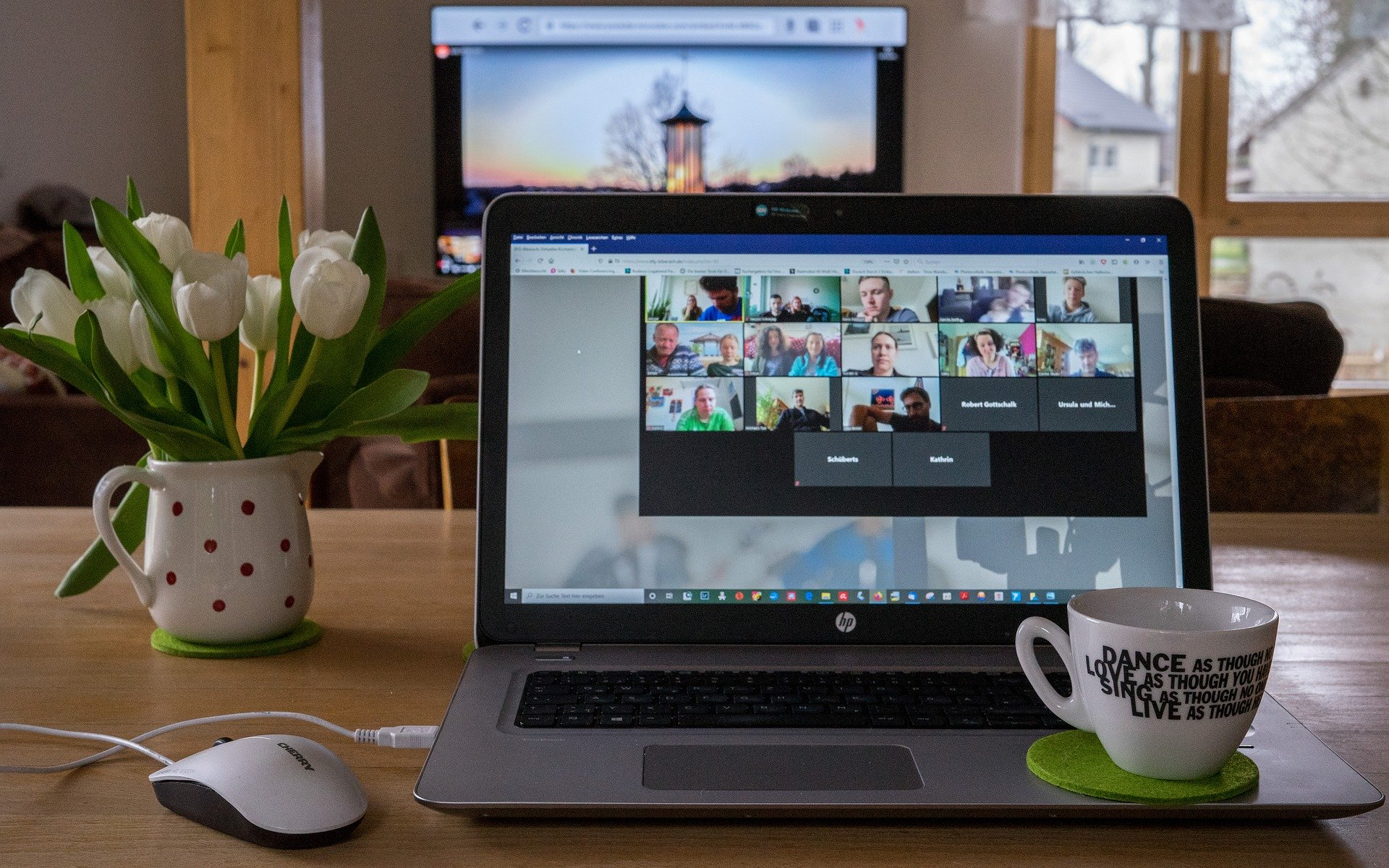A laptop with a virtual meeting