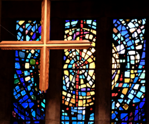 Cross and stained glass window
